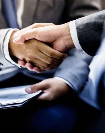Lawyer and Client Handshake